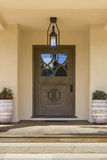 Front door with brown wood. Stock Photos
