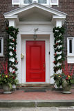 Front door with Christmas decorations Royalty Free Stock Images