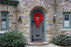 Front door with Christmas decorations Royalty Free Stock Photo