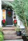 Christmas front door. Front door with a Christmas wreath and bows Royalty Free Stock Photo