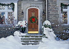 Front door with Christmas wreath Royalty Free Stock Photography