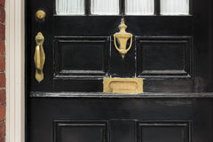Front door, close up with brass fixtures Royalty Free Stock Photos