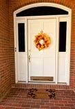 Front Door. Decorative autumn wreath on a white front door Stock Photo