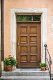 Front door with decorative flowers Stock Image