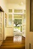 Front Door Entrance Interior. The entrance to a home with the front door open and looking from the interior to the outside