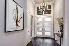 Front door entrance to modern house with hardwood floors. Luxury interior royalty free stock photo