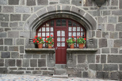 A front door is flanked by pots of flowers (France) Stock Photography
