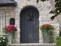 Front door with flower pots Royalty Free Stock Photo