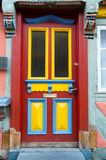 Front door with glass windows and painted wooden board Royalty Free Stock Photo