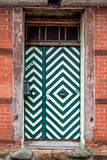 Front door with green and white pattern in an old house Royalty Free Stock Images