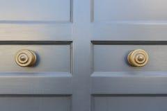 Front door, grey with knobs. Front door, grey ornate knobs Royalty Free Stock Photo