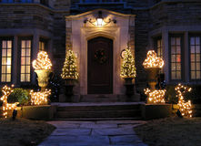 Front door with holiday lights. And shrubbery royalty free stock images