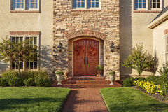 Front door, horizontal view of front door with beautiful landscaping Stock Image