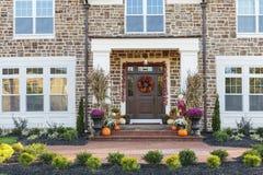 Front door, horizontal view of front door with seasonal decor Stock Image