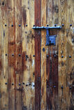 Front Door of House. Foreground of a rustic brown door closed Royalty Free Stock Photos