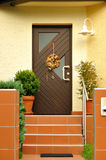 Front door of the modern house. Front view of an modern house door entrance Royalty Free Stock Photos