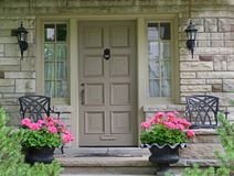 Front door of house. With flower pot royalty free stock photo