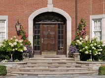 Front door with hydrangeas Stock Images