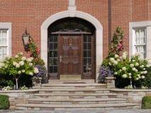 Front door with hydrangeas stock images