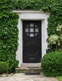 Front door with ivy Stock Photography