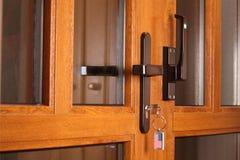 Front door with key. Stock Photos