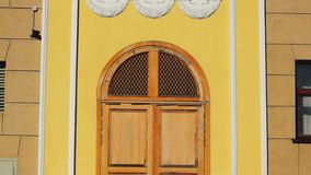 Front door in old architectural style tilt up stock video
