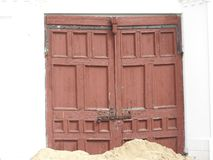 Front door of an old, ruined building, the old front door royalty free stock photography