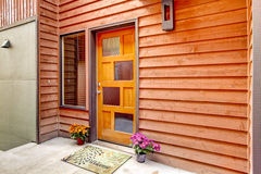 Front door with open porch and flower pots Stock Photography