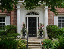 Front door with portico entrance Royalty Free Stock Photo