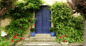 Front door with pots and plants Stock Photos