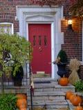 Front door with pumpkins Stock Photo