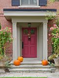 Front door with pumpkins Stock Photo
