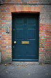 Front Door of a Red Brick House Royalty Free Stock Photos