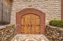 Front door of a rustic wine cellar. Royalty Free Stock Photos