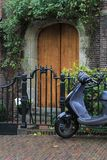 Front door and scooter. Royalty Free Stock Photography