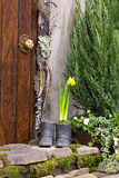 Front door with spring flowers Royalty Free Stock Photo