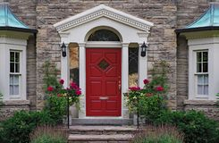 Front door of stone house. With flowers royalty free stock photography
