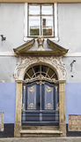 The front door to the old house. With stucco decorations Royalty Free Stock Photography