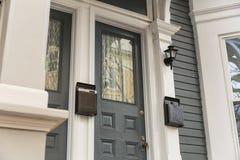 Front door in urban setting stock photos