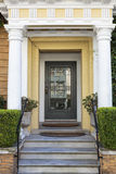 Front door, vertical with yellow paint Royalty Free Stock Image
