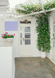 The front door and window with flowers. Royalty Free Stock Photos