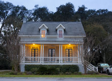 Front elevation of house at twilight. Front elevation of house lit up at twilight stock images