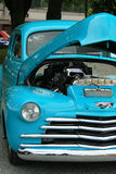 Front end of a blue car. With its hood up stock photo
