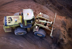 Front End Loader. Working Gold Ore stockpile to send to processing plant Royalty Free Stock Photo