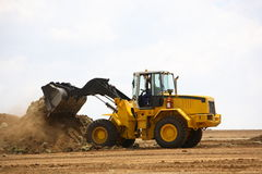 Front end loader. Clearing a construction site stock image