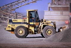 Front End Loader. Working stockpile at Quarry processing plant Royalty Free Stock Image