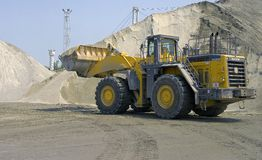 Front end loader. Loading sand with a large Komatsu loader at a stone quarry Stock Images