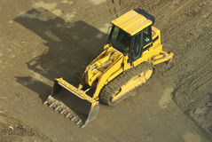 Front End Loader. Overhead view of a yellow front end loader (bulldozer type machine) on a construction site stock images