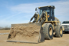 Front-end Loader. Equipment in a construction site in a residential area Royalty Free Stock Image