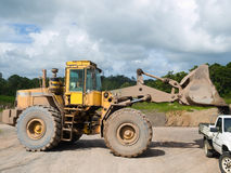 Front end loader. Loading gravel into a work pickup vehicle stock photography